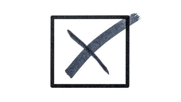 Schwarzes Kreuz in einer kleinen Box auf weißem Hintergrund – Foto