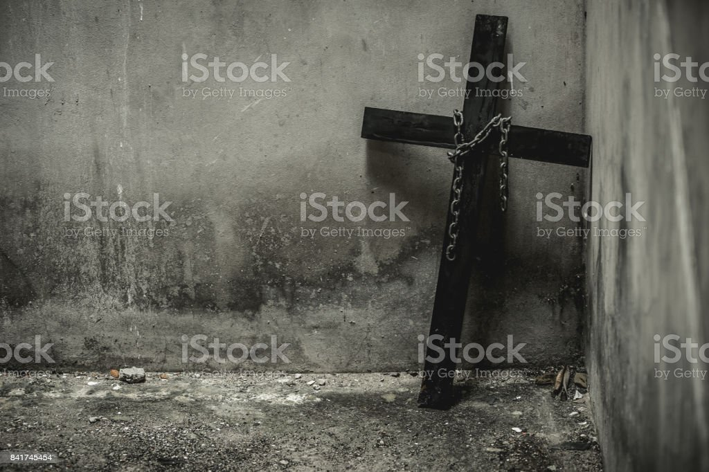Black cross with a looped chain. stock photo