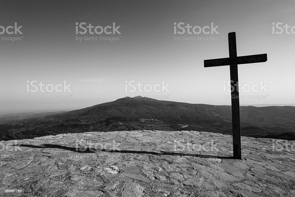 Black cross with mountain in background royalty-free stock photo