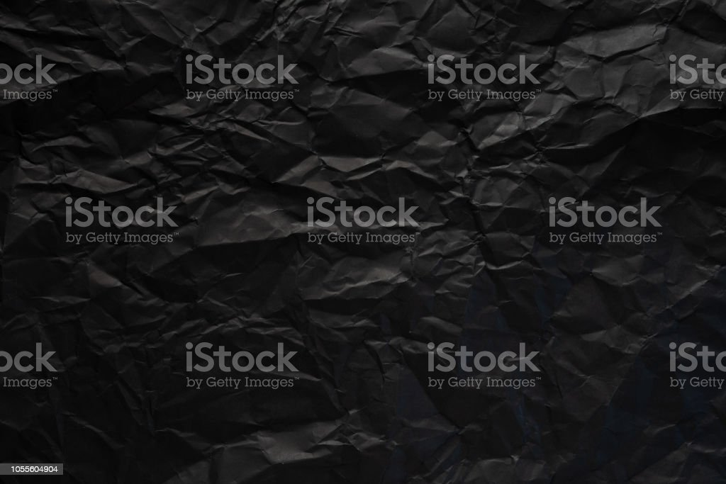 Black crumpled paper texture background. stock photo