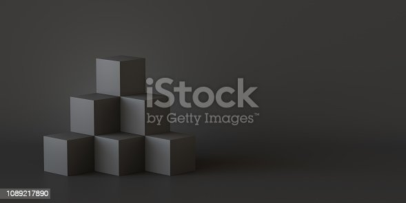 istock Black cube boxes with dark wall background. 3D rendering. 1089217890
