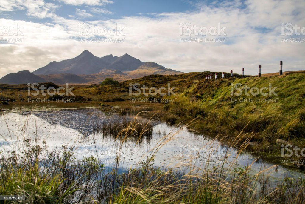 Black Cuillin Mountains in Scotland with pond stock photo