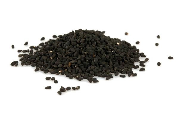 black cumin isolated on white background stock photo