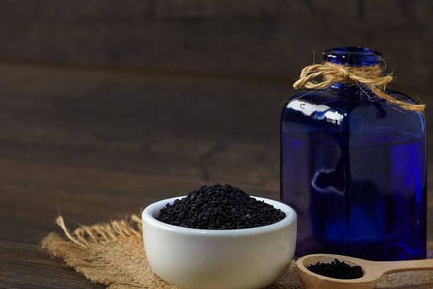 Black cumin seeds stock photo