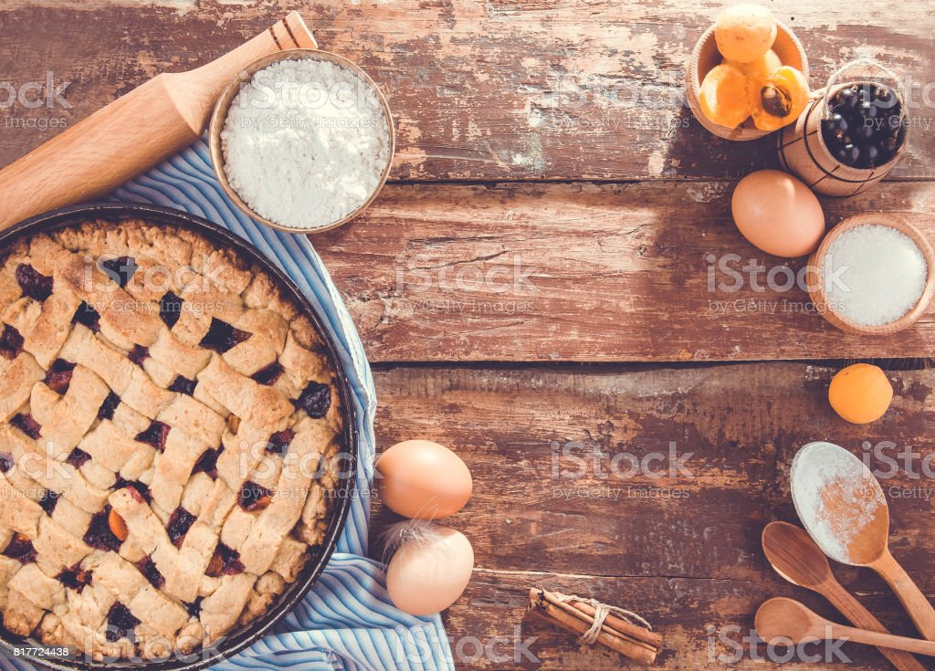 Black currant and apricot pie with ingredients stock photo