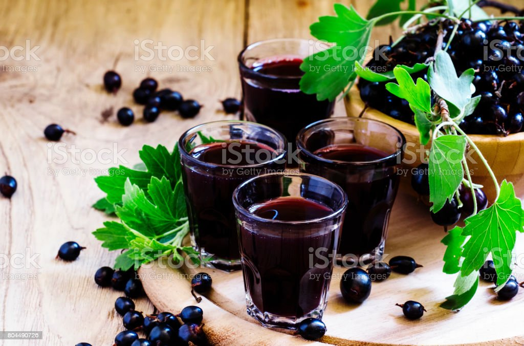 Black currant juice in glass, selective focus stock photo