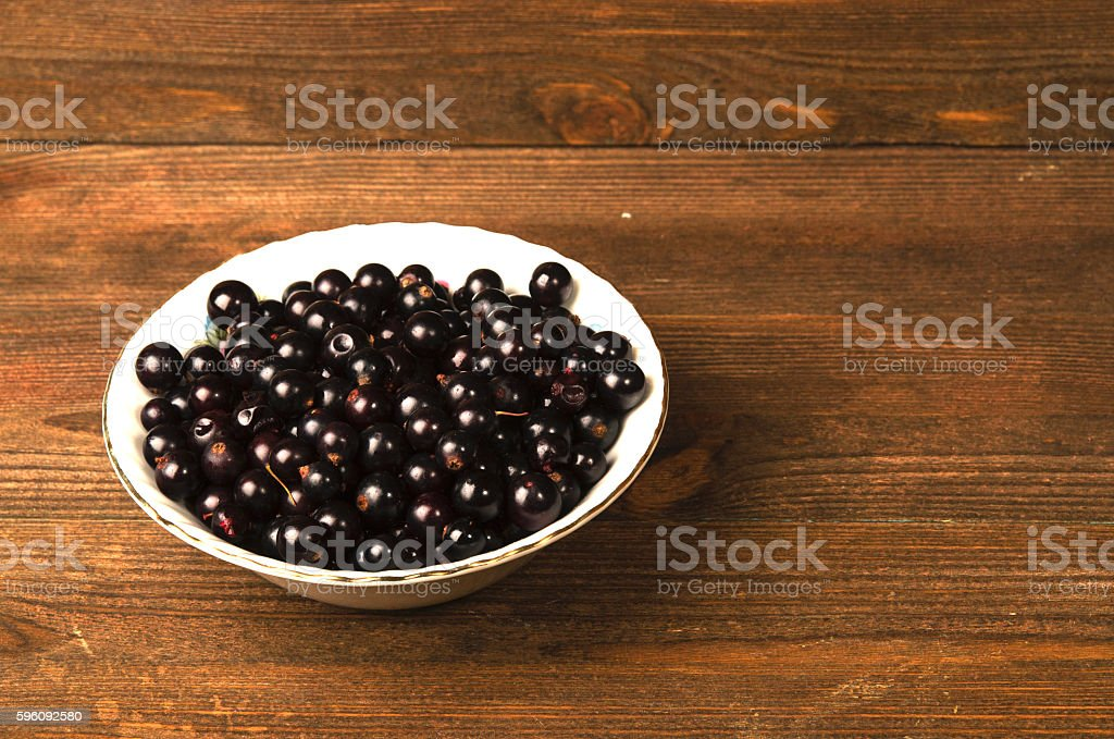 black currant on a wooden background. royalty-free stock photo