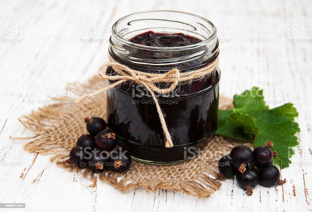 Black currants jam and fresh berries stock photo