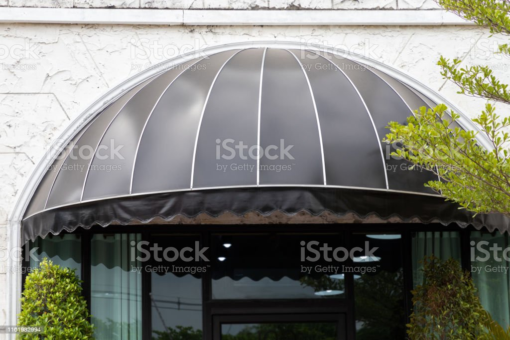 Black Curve Awning Over The Entrance Door Of Shop Canvas Shading Decoration Stock Photo Download Image Now Istock