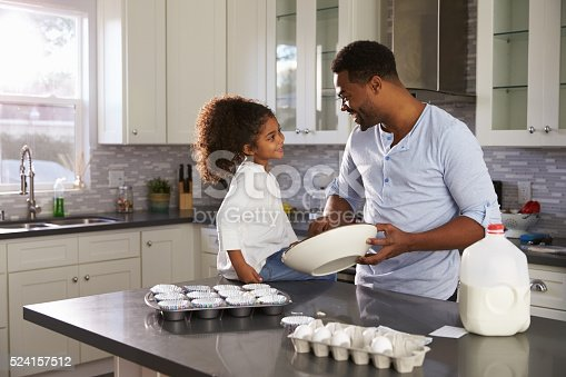 istock Black dad and young daughter look at each other while 524157512