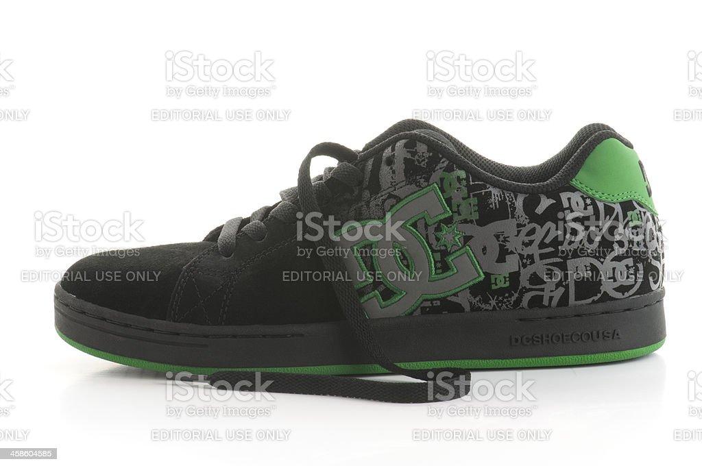 Black DC shoe on white background royalty-free stock photo