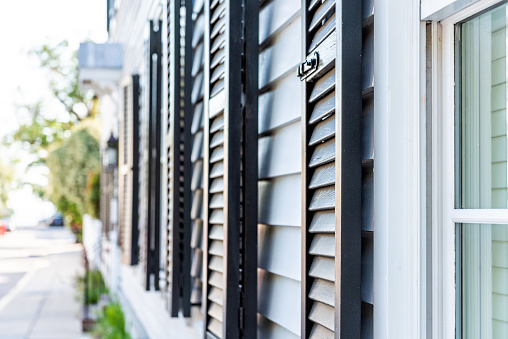 istock Black decorative row of window shutters closeup architecture open exterior of houses buildings or homes in Charleston, South Carolina southern city 1091912278