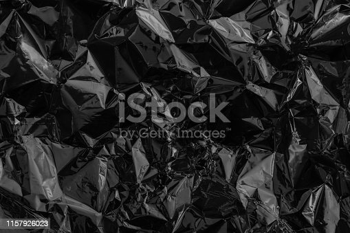 istock Black deformed cellophane or plastic. Environmental problem concept 1157926023