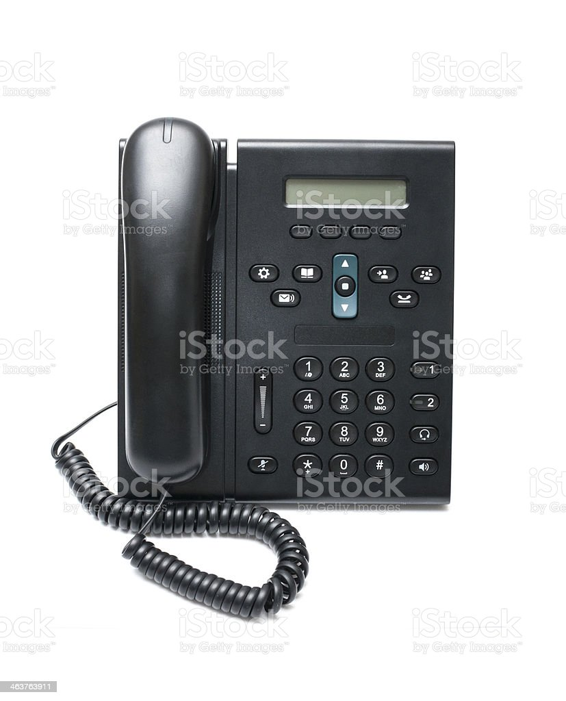 Black desk phone on a white background stock photo