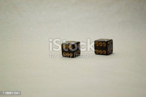 black dice on a light background