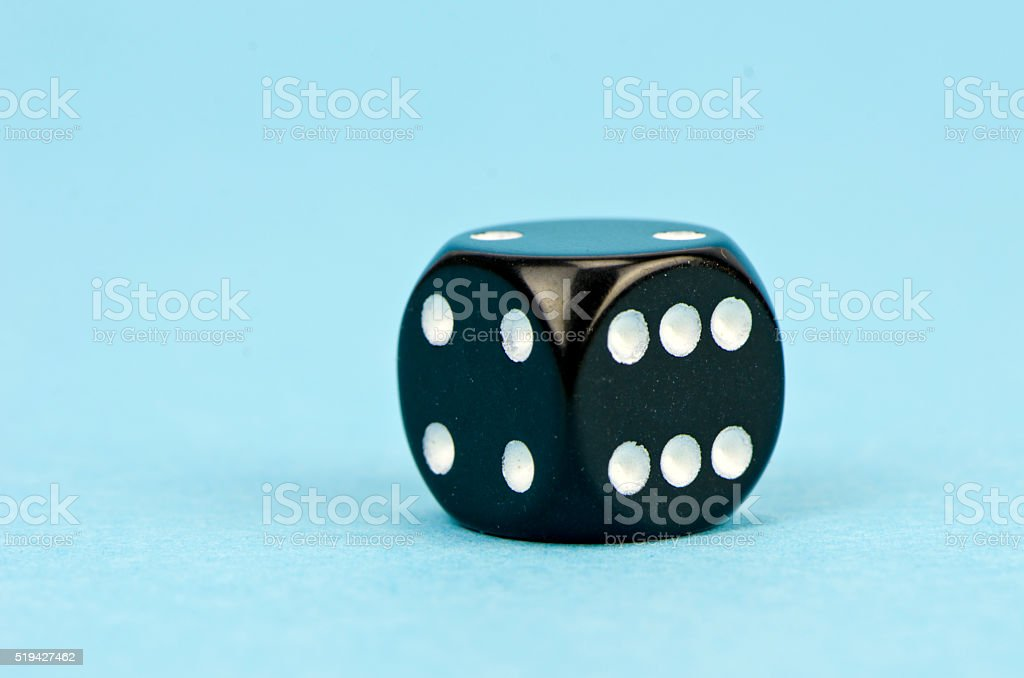 black dice with number six stock photo
