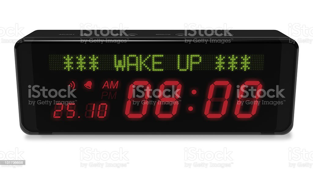 A black digital alarm clock on a white background stock photo