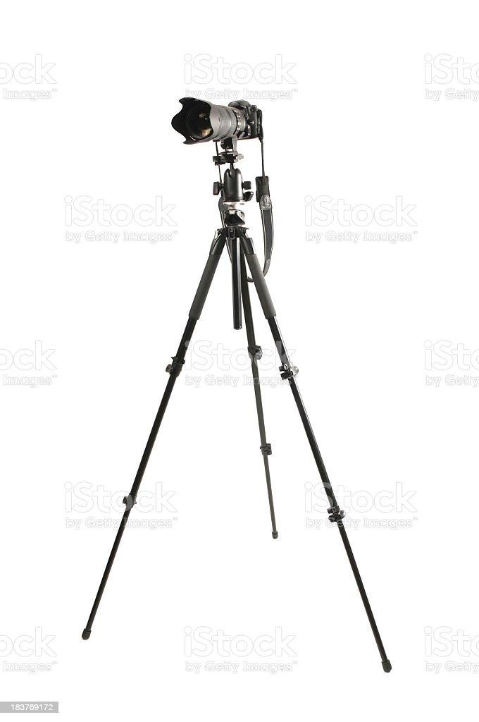 Black digital camera on tripod isolated stock photo