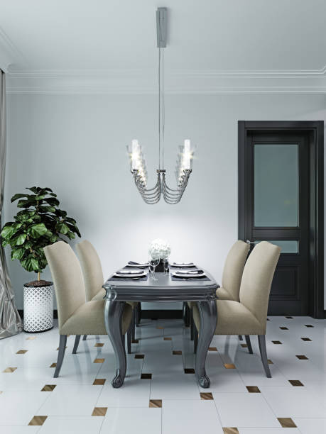 Black dining table with four soft chairs in beige. The interior is in a classic style.