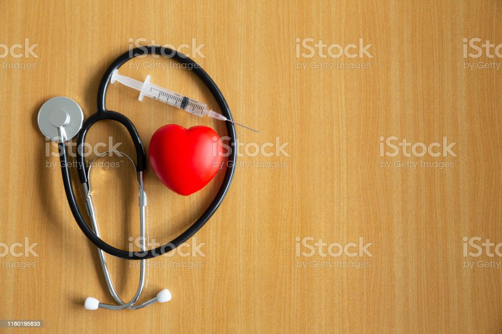 Black doctor stethoscope.Injection needle and stress ball in heart...
