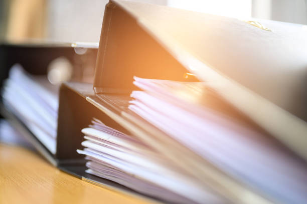 Black document file on the office desk Black document file on the office desk ring binder stock pictures, royalty-free photos & images