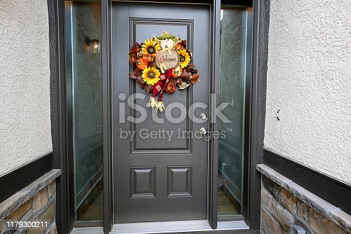 istock Black Door Halloween Wreath 1179300211