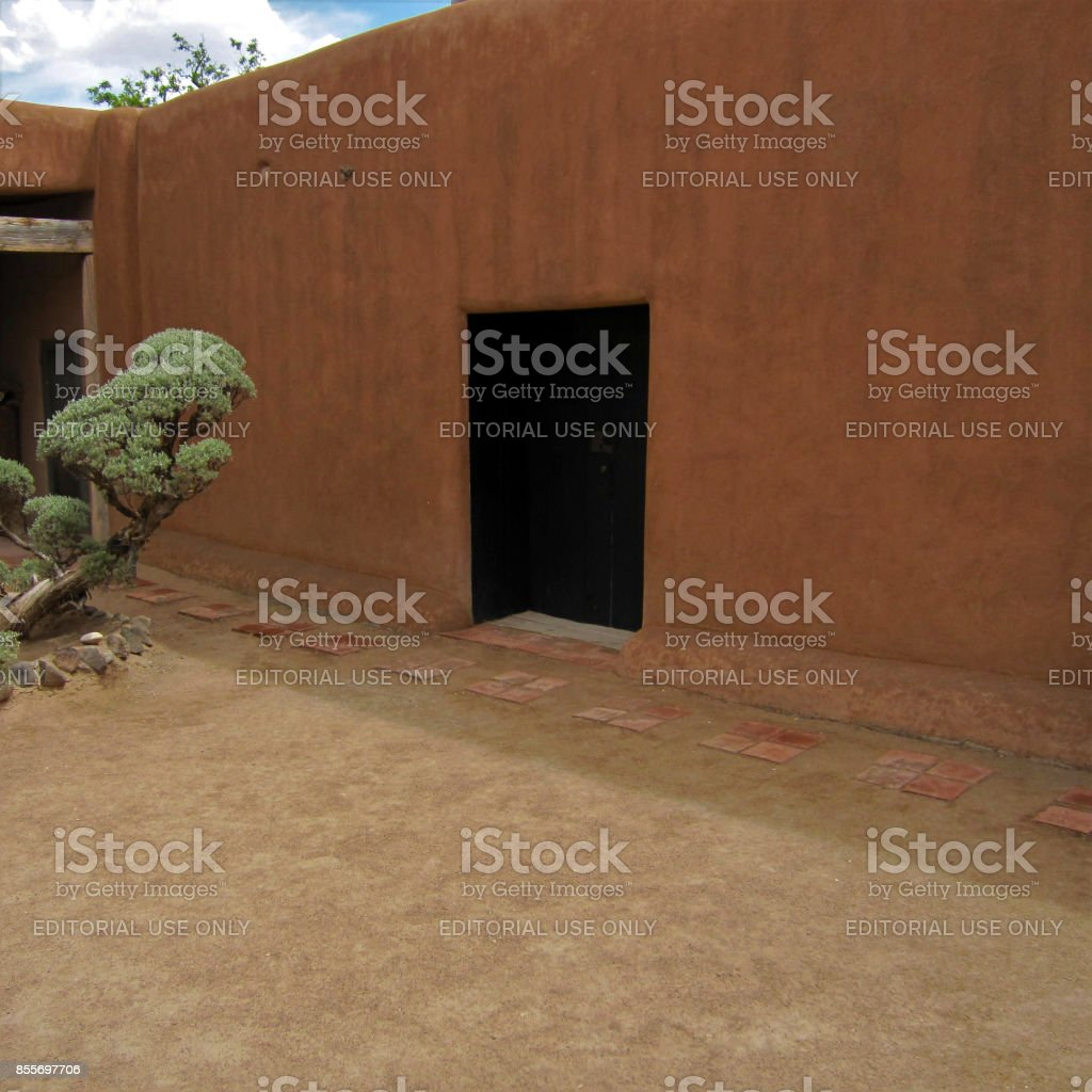 Black Door in Adobe Wall Made Famous by Georgia O'Keeffe stock photo