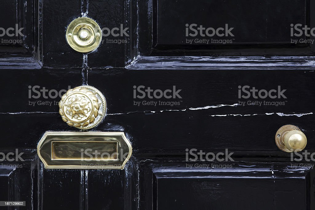 black door with letterbox, handle and ring bell stock photo