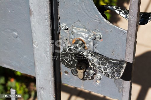 Black doorknog of gate to frontyard