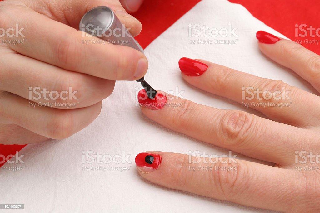 Black dot on fingernails royalty-free stock photo
