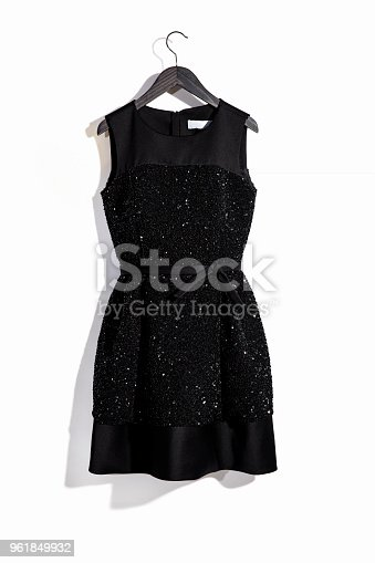 Black dress on hanger isolated on white background ( with clipping path)