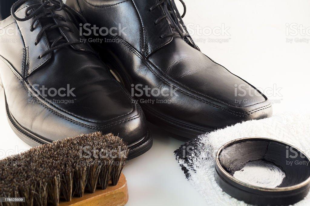 Black Dress Shoes and Polish Kit stock photo