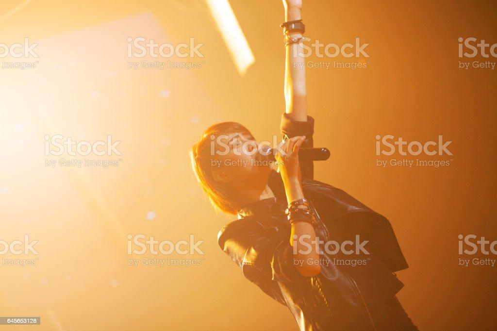 Black dressed thai rock singer girl in lights stock photo