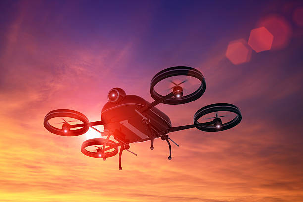 black drone flying in the sky at sunset, lens flare - big brother orwellian concept stock pictures, royalty-free photos & images