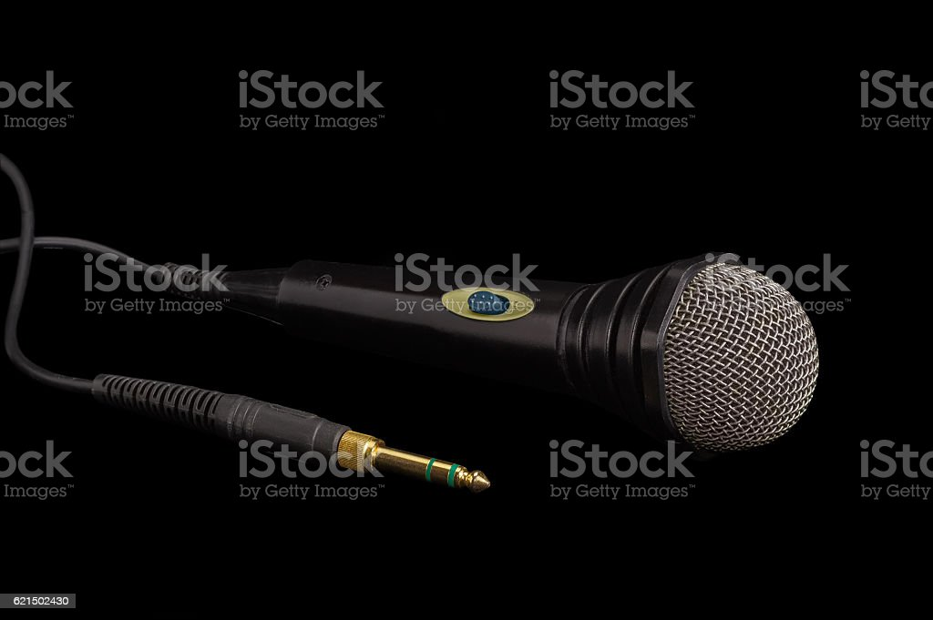 Black dynamic microphone and connector on a dark background Lizenzfreies stock-foto