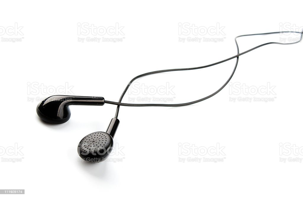 Black ear buds on white background stock photo