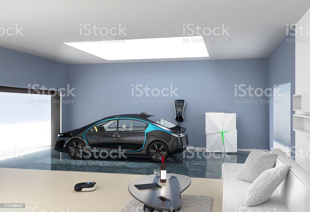Black electric car park into modern garage room stock photo