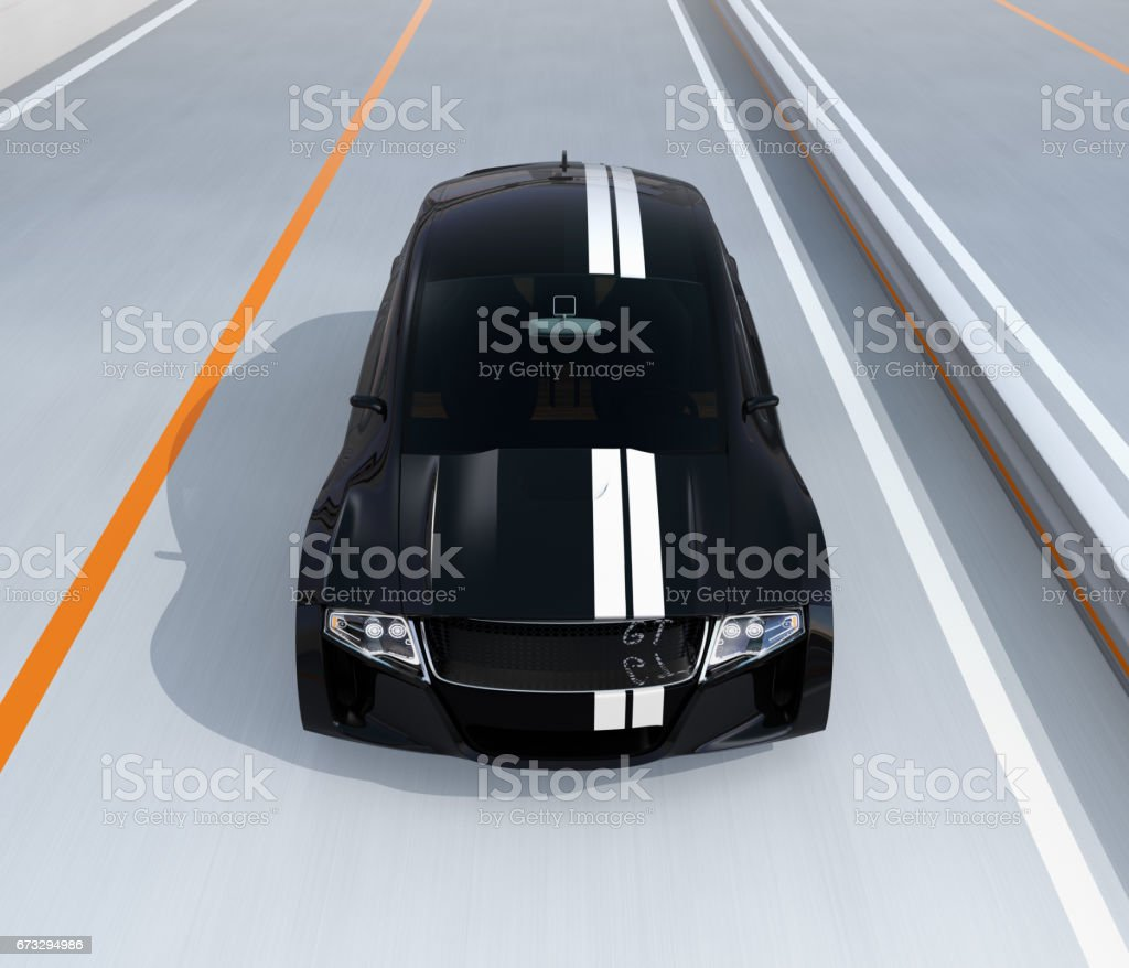 Black electric sports car driving on the highway royalty-free stock photo