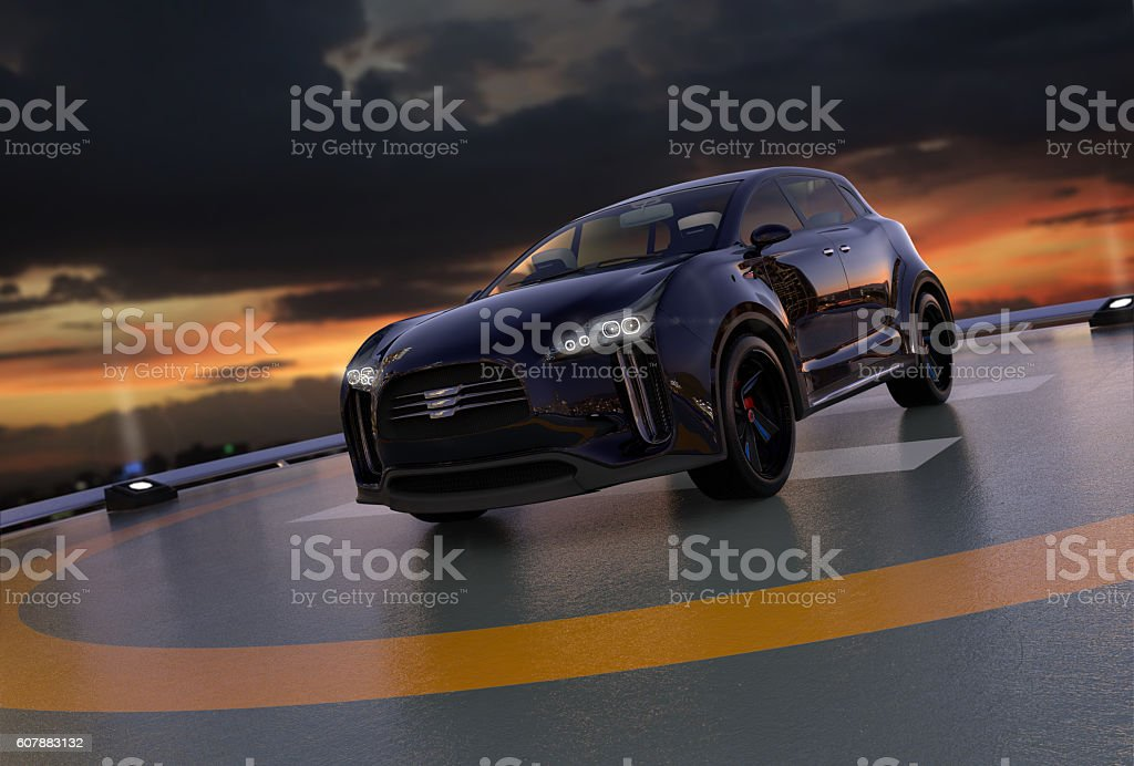 Black electric SUV parking on the helipad on building stock photo