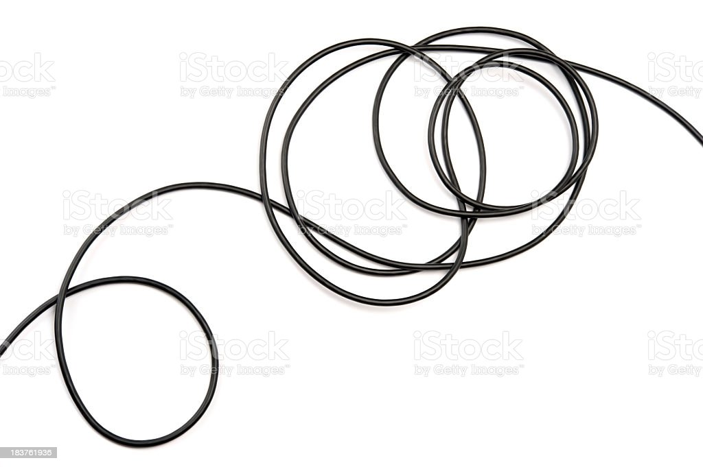 Black electrical cable against white background stock photo