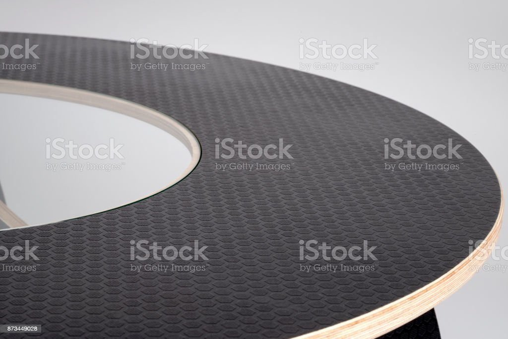 Black Embossed Rubber Covering of Designer Wooden Round Table Top stock photo