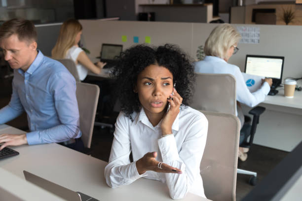 Black employee talking with client on phone solve problem distantly stock photo