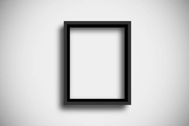 Black empty frame on the white wall stock photo