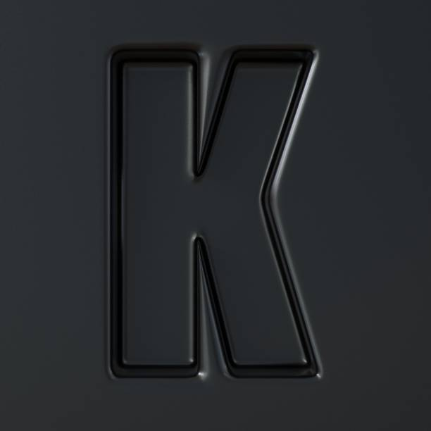 Black engraved font Letter K 3D Black engraved font Letter K 3D render illustration on black background k logo stock pictures, royalty-free photos & images