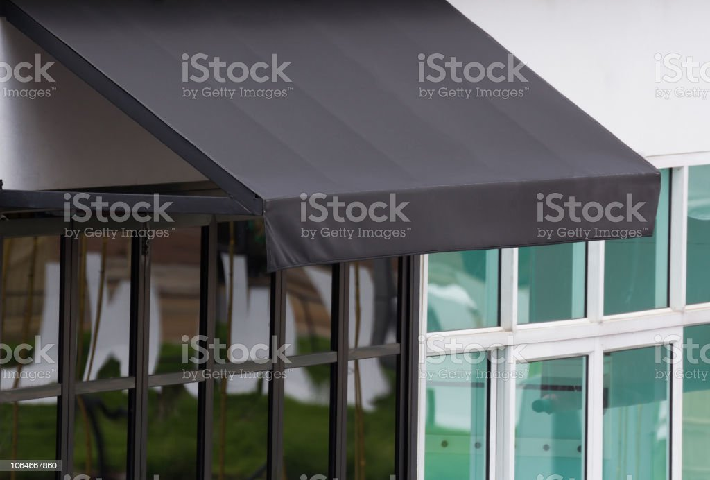 Black Exterior Awning Over Aluminium Frame Window Of Shop Sun Light On Black Canvas Shading Stock Photo Download Image Now Istock