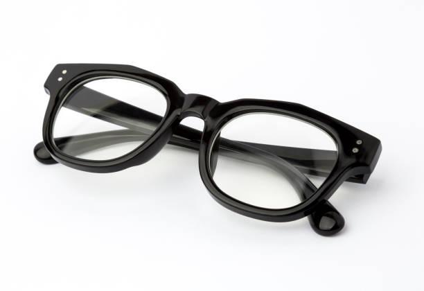 schwarze brillen gefaltet isolated on white - klapprahmen stock-fotos und bilder