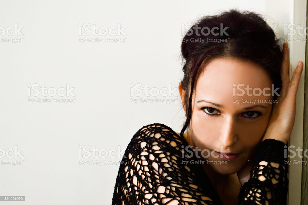 Black eyed woman looking straight in camera royalty-free stock photo