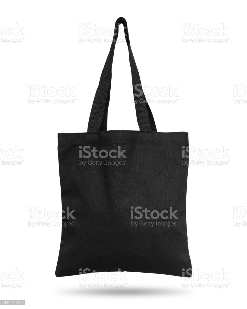 Black fabric bag isolated on white background. Cloth handbag for your design. Recycled material. Clipping paths object. stock photo