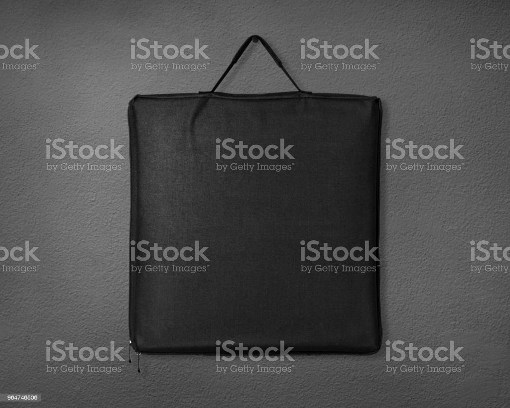 Black fabric bag on cement background. Shopping canvas bag for design. royalty-free stock photo