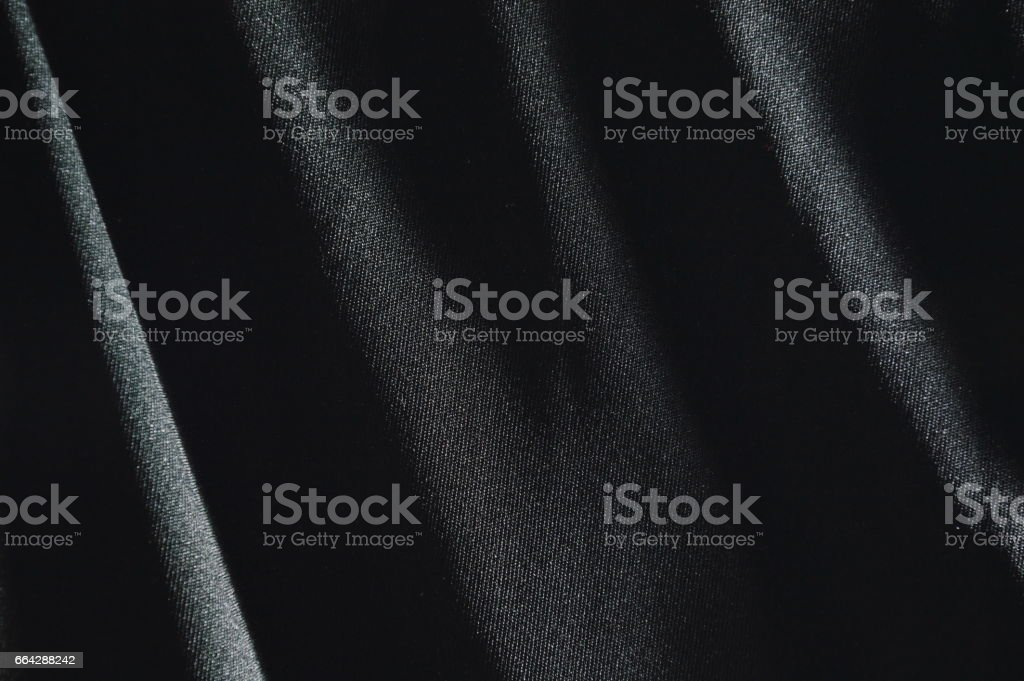 black fabric in shadow background and texture stock photo